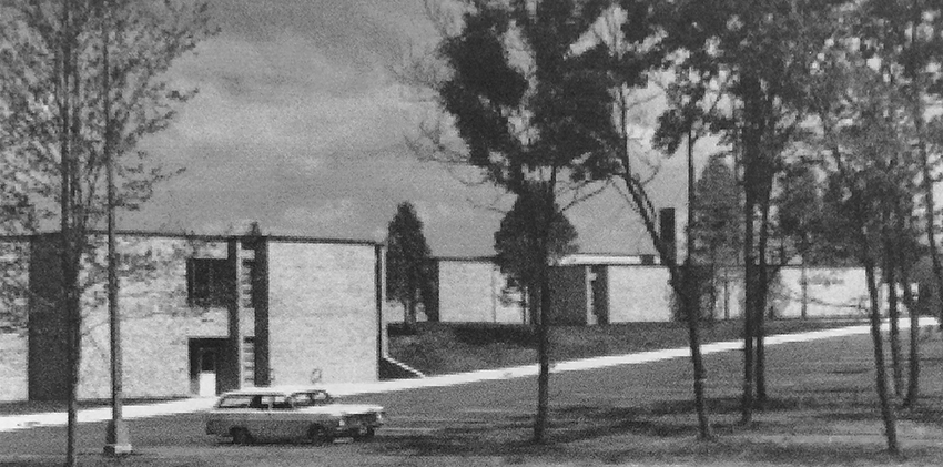 Black and white photograph of Wolftrap Elementary School taken in 1968. The front of the building is pictured and one car, a station wagon, is parked in front of the school.